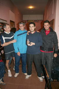 Александр Рогальский (второй справа) получил награду за победу в парном турнире 2007 года